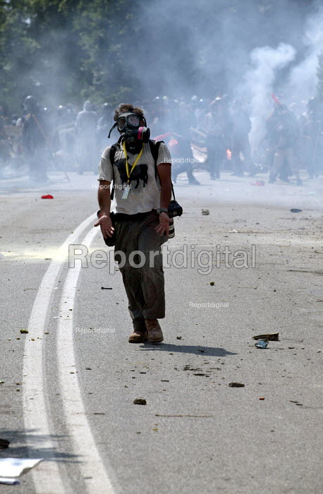 Yannis Behrakis Reuters photographer confronts police lines after having his camera smashed by police in a charge. Clashes inside the Red Zone security cordon surrounding the European Union Summit in Halkidiki, Greece. - Jess Hurd - 2003-06-20