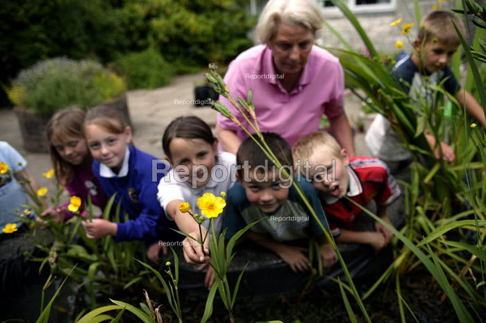 Year 3 children from Langley Junior School take part in gardening activities with volunteer Rose Perkis, ex Meal Time Assistant (who was pensioned at 60). Part of the Government Pathfinder project, piloted in Plymouth to reduce teacher workload. - Jess Hurd - 2003-07-02