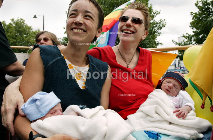 Lesbian couple with their newly born twins ride a float. London Gay Pride 2003.. - Jess Hurd - 2003-07-26