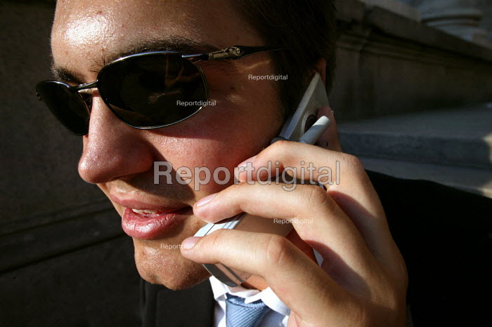 City businessman on a mobile phone outside The Royal Exchange, Bank, City of London. - Jess Hurd - 2003-07-15