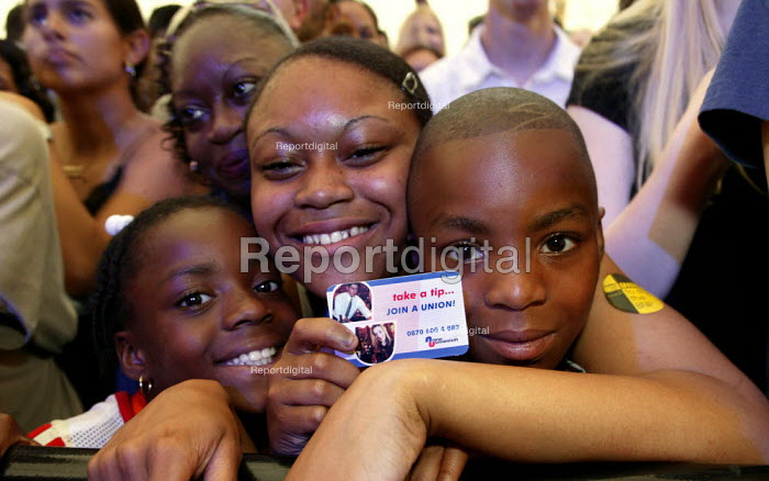 Young women with TUC join a union card at the Respect Festival, Millennium Dome. - Jess Hurd - 2003-07-19