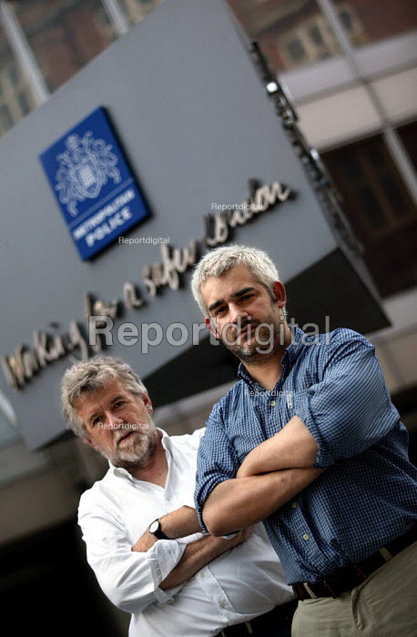 Journalists investigating police corruption - Michael Gillard and Laurie Flynn pictured outside New Scotland Yard. London. - Jess Hurd - 2003-08-13