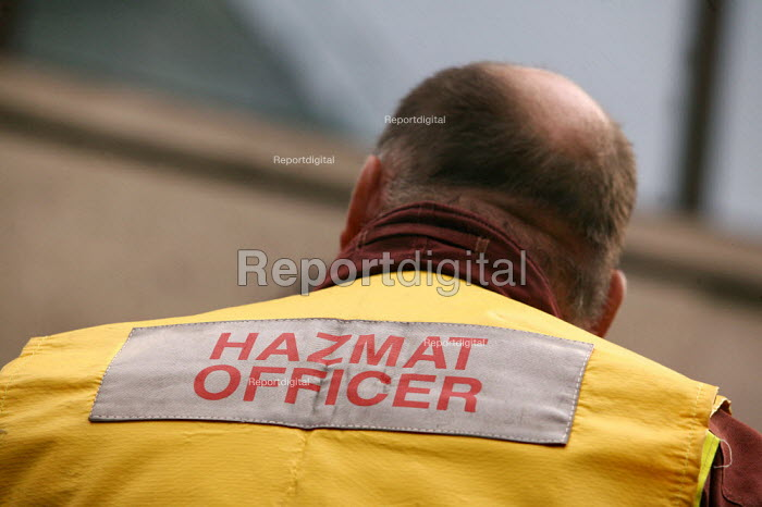 Hazmat (hazardous materials) specialist firefighter wears an identification tabard during an exercise simulating a chemical agent terrorist attack on Bank Underground station in London. - Jess Hurd - 2003-09-06