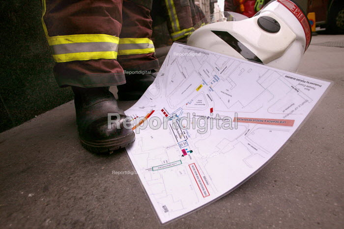Firefighters with a site map during an exercise simulating a chemical agent terrorist attack on Bank Underground station, London - Jess Hurd - 2003-09-06