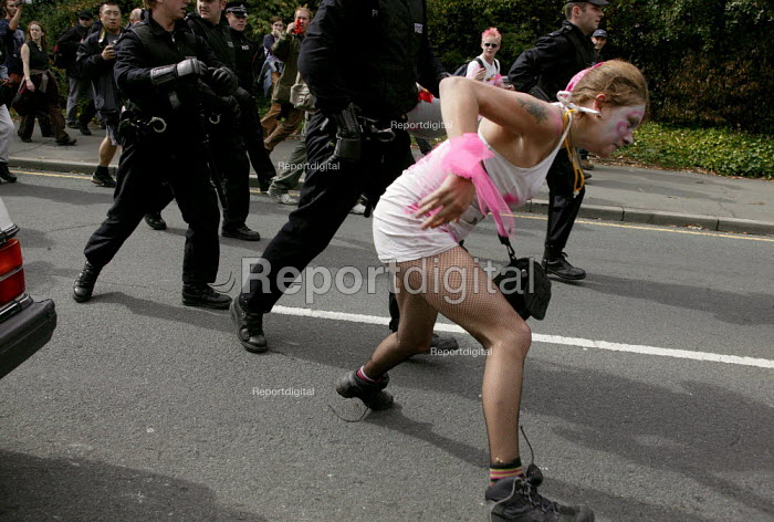 Protester evades police arrest at the Defence Systems and Equipment International Arms Fair, Excel Centre, London. Police used anti-terrorist legislation to arrest, and stop and search protestors. - Jess Hurd - 2003-09-10
