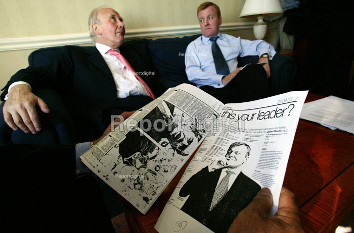 Menzies Campbell QC MP helps leader Charles Kennedy with his Conference speech. Liberal Democrat Party Conference 2003. - Jess Hurd - 2003-09-24