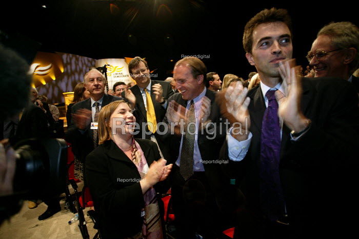 Sarah Teather the new MP for Brent East and Simon Hughs MP applaud leader Charles Kennedy at Liberal Democrat Conference. - Jess Hurd - 2003-09-25