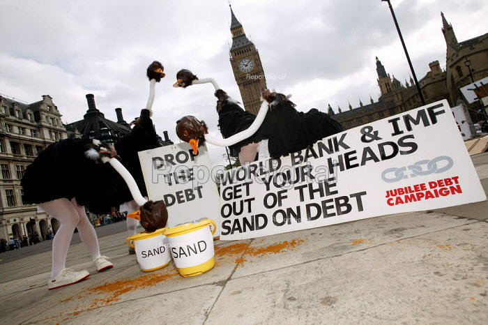 Jubilee Debt campaign perform an ostrich protest against third world debt. Urging the World Bank and IMF to take action against poverty and not keep their heads in the sand outside Westminster and the House of Parliament, London. - Jess Hurd - 2003-09-19