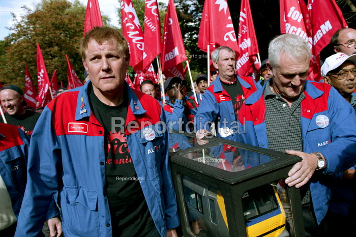 Alstom workers carry a coffin with a model of train that represents the loss of their jobs. AMICUS, TGWU, MSF and UCATT join the Unions for Manufacturing march on Labour Party Conference 2003. - Jess Hurd - 2003-09-28