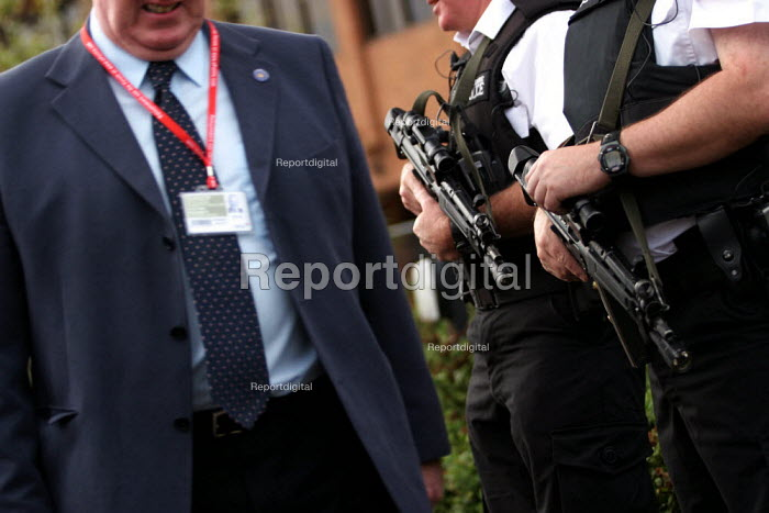 Delegate walks through the security cordon with armed guards at Labour Party Conference 2003. - Jess Hurd - 2003-09-30