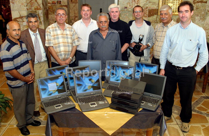 UK trade unions meet with and donate gifts of laptop computers and printers to representatives from the Workers Democratic Trade Union Movement WDTUM in Baghdad, Iraq. - Jess Hurd - 2003-10-05