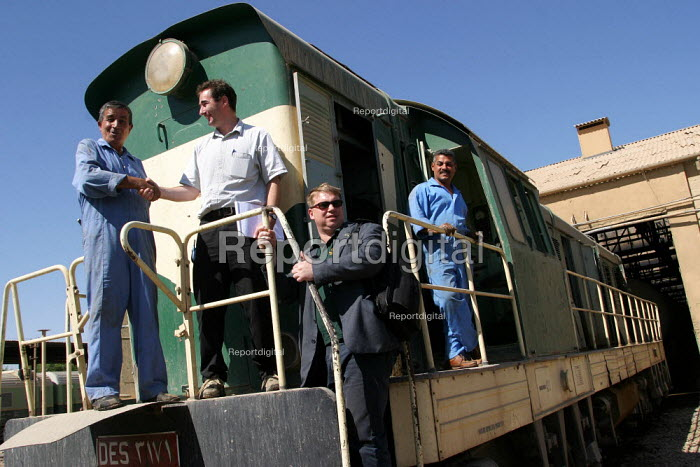 RMT member Alex Gordon and TSSA member Dave Barnes greet rail workers at Baghdad maintenance depot. On the first solidarity trip, UK trade unions meet with representatives from the Workers Democratic Trade Union Movement WDTUM. Baghdad, Iraq. - Jess Hurd - 2003-10-06