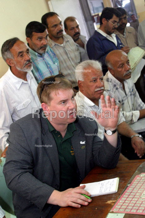 RMT member Alex Gordon speaks at a meeting with rail workers at a Baghdad depot. On the first solidarity trip, UK trade unions meet with representatives from the Workers Democratic Trade Union Movement WDTUM. Baghdad, Iraq. - Jess Hurd - 2003-10-06