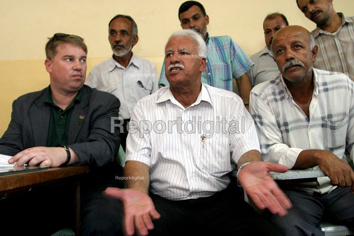 RMT member Alex Gordon sits with the General Secretary of the WDTUM at a meeting of rail workers at a Baghdad depot. On the first solidarity trip, UK trade unions meet with representatives from the Workers Democratic Trade Union Movement WDTUM. Baghdad, Iraq. - Jess Hurd - 2003-10-06