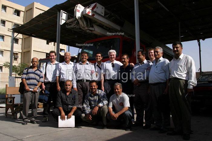 FBU, RMT and TSSA members with Iraqi firefighters in the Civic Defense Department. On the first solidarity trip, UK trade unions meet with representives from the Workers Democratic Trade Union Movement WDTUM. Baghdad, Iraq. - Jess Hurd - 2003-10-06