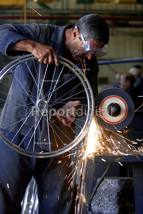 Woman working in a Bicycle factory. Baghdad, Iraq. - Jess Hurd - 2003-10-06