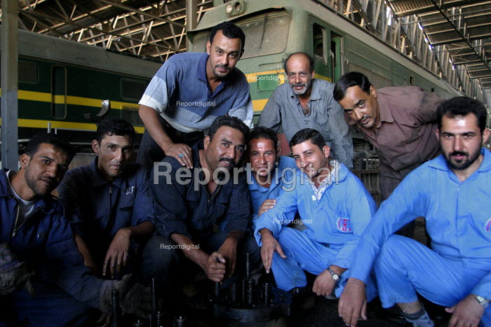 Rail workers at Baghdad maintenance depot. On the first solidarity trip, UK trade unions meet with representatives from the Workers Democratic Trade Union Movement WDTUM. Baghdad, Iraq. - Jess Hurd - 2003-10-06