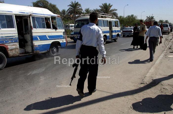 Iraqi policeman with an AK 47. Baghdad, Iraq. - Jess Hurd - 2003-10-07