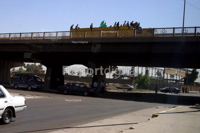 Islamic demonstrators ride an opentop truck with flags through Baghdad, Iraq. - Jess Hurd - 2003-10-07