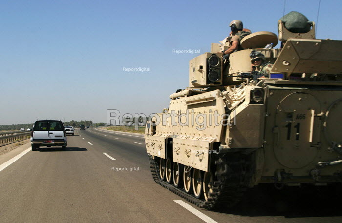 America Army tank on patrol Baghdad, Iraq. - Jess Hurd - 2003-10-08