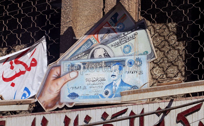 Sign showing Iraqi Dinar at a currency exchange. Baghdad, Iraq 2003 - Jess Hurd - 2003-10-08