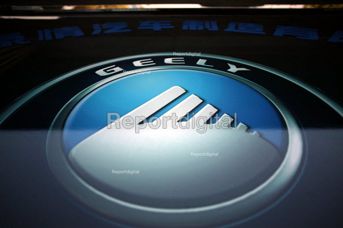 Private owned Geely Corporation car logo. The car maker currently sell approx 90,000 vehicles a year to the China market only. Linhai, Zhejiang Province, China. - Jess Hurd - 2003-10-16