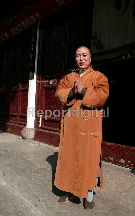 Monk at the Guoqing Buddhist Temple, Tiantai, Zhejiang Province, China. - Jess Hurd - 2003-10-17