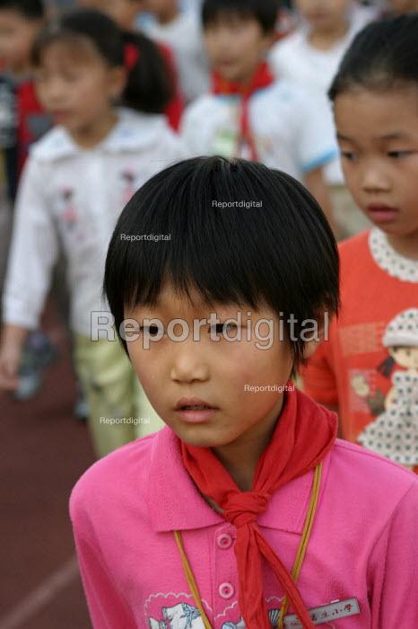 Chinese children march in an exercise class, Shu Sheng Private private Middle School run by the Sunson Company, Jiaojiang, Taizhou, Zhejiang Province, China - Jess Hurd - 2003-10-15