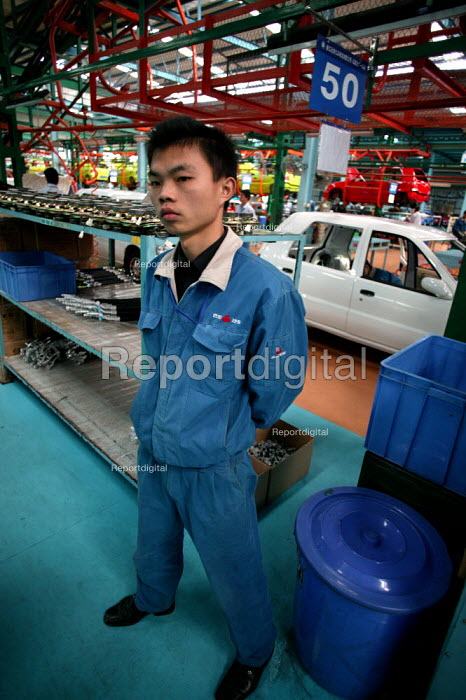 Private owned Geely Corporation car assembly line. The company currently produces approx 90,000 vehicles a year to the China market only. Linhai, Zhejiang Province, China. - Jess Hurd - 2003-10-26