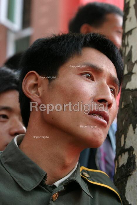 Man in the audience at the Hangzhou Silk Fashion Show Zhejiang Province, China. - Jess Hurd - 2003-10-18