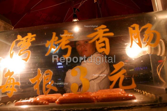 Street vendor selling hotdogs, Shanghai, China. - Jess Hurd - 2003-10-20