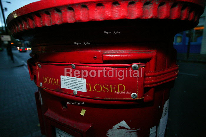 Sealed up post box with a Royal Mail sticker that apologises for the closure due to the CWU unofficial strike action. North London. - Jess Hurd - 2003-11-03