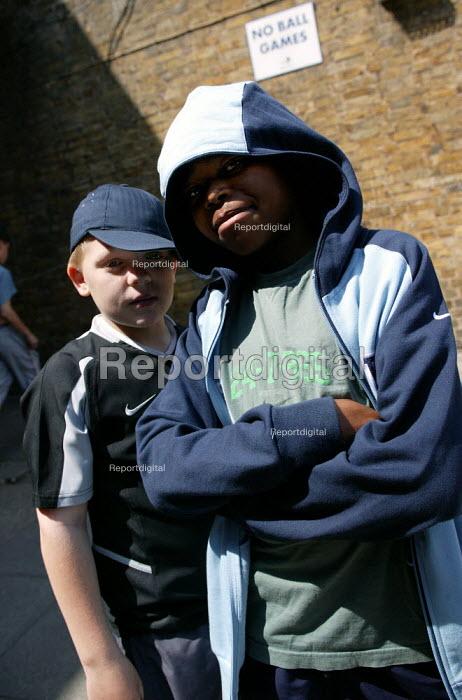 Youth pose for photograph, Chrisp Street Market, Poplar, East London. - Jess Hurd - 2003-06-14