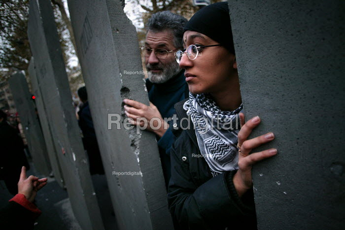 Pro Palestinian activists with a replica Separation wall representing the concrete wall erected by Israeli forces through the West Bank. European Social Forum demonstration, Paris - Jess Hurd - 2003-11-15