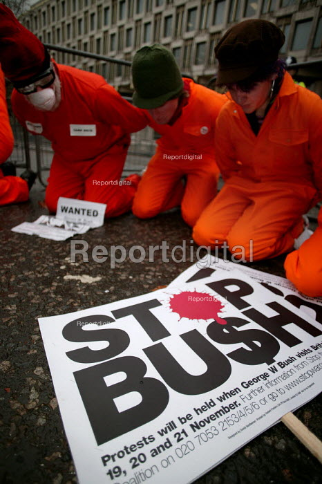 Protestors dressed as detainees at Camp Delta, Guantanamo Bay, campaigning to free the prisoners, American Embassy. Stop the War Coalition protest against the State visit of US President George Bush to the UK, London - Jess Hurd - 2003-11-21