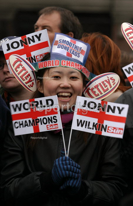 Chinese England fan celebrates Rugby World Cup win. Trafalgar Square. London. - Jess Hurd - 2003-12-08