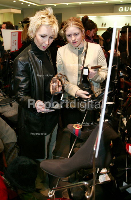 Gucci designer shoe shopping. The Opening day of the Harrods Sale. London. - Jess Hurd - 2003-12-30