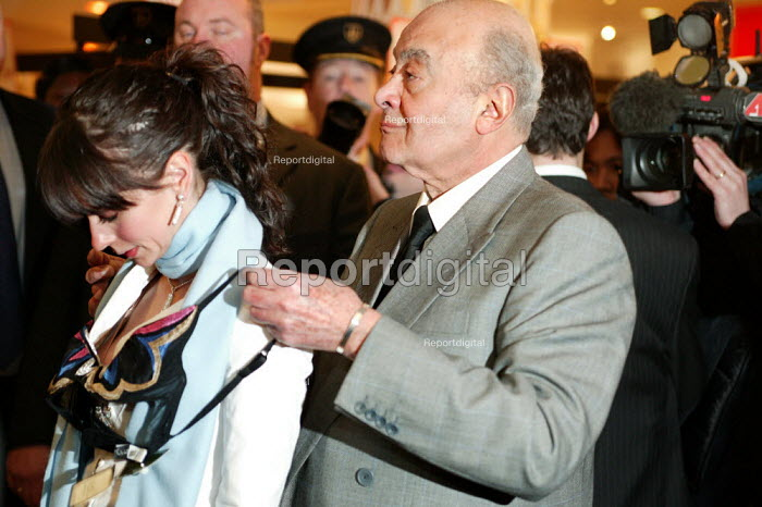 Harrods owner Mohammad Al Fayed drapes an expensive bra around Hollywood actress Jennifer Love Hewitt in the lingerie department. The Opening day of the Harrods Sale. London. - Jess Hurd - 2003-12-30