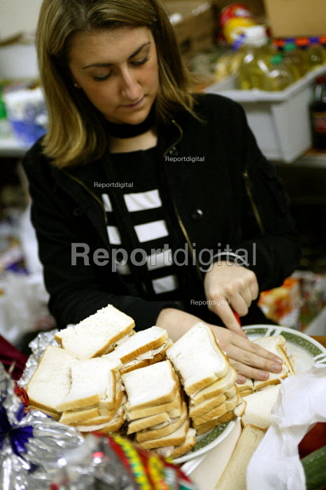 Local student and Volunteer makes turkey sandwiches for the homeless. Christmas Day night at the Newham Night shelter for the homeless, 170 Harold Road, East london. - Jess Hurd - 2003-12-25