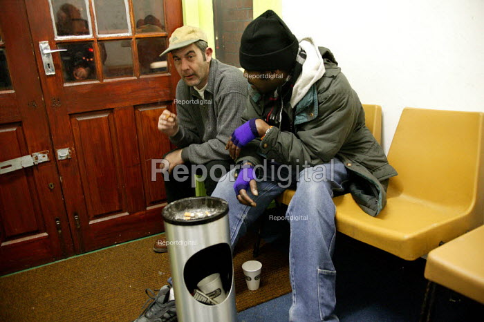 Rough sleepers have a smoke before bedding down for Christmas Day night at the Newham Night shelter for the homeless, 170 Harold Road, East london. - Jess Hurd - 2003-12-25