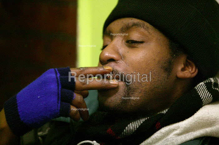 Young homeless man spends Christmas Day night at the Newham Night shelter for the homeless, 170 Harold Road, East london. - Jess Hurd - 2003-12-25