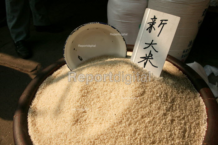 Rice for sale in the Old Town Ghost Market, Shanghai, China. - Jess Hurd - 2003-10-26
