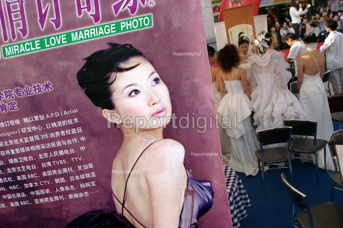 Hangzhou Miracle Love Marriage Fashion Show for prospective couples wanting a Western wedding. Zhejiang Province, China. - Jess Hurd - 2003-10-17