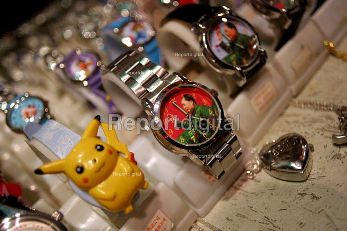 Pokemon watches on sale alongside Chairman Mao waving, Shanghai, China. - Jess Hurd - 2003-10-20