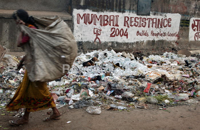 Women collecting rubbish for recycling, World Social Forum banner, Mumbai, India - Jess Hurd - 2004-01-23