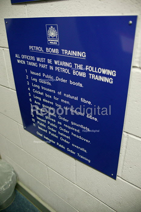 Petrol bomb training health and safety instructions. Metropolitan Police Public Order Training Centre, Gravesend, Kent. - Jess Hurd - 2004-03-04