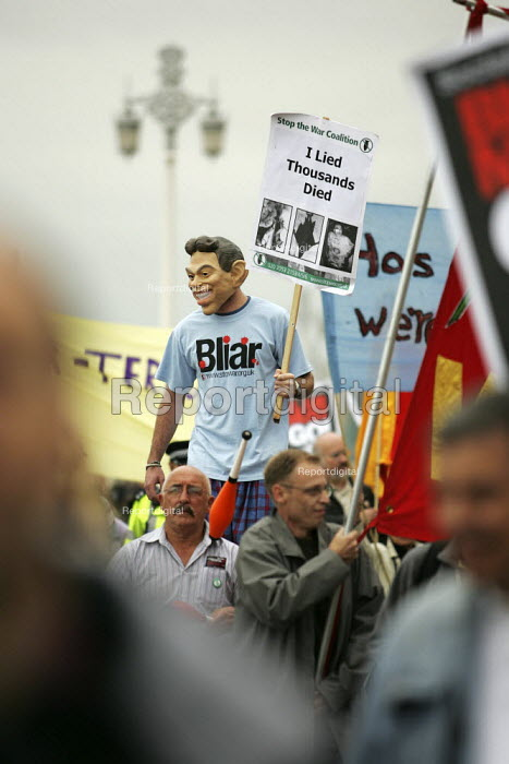A protester wears a Tony Blair mask during an anti war march outside Labour Party Conference. - Jess Hurd - 2004-09-29