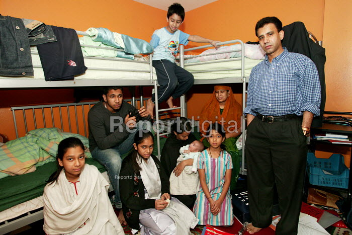 Bengali family Sanur Ali with wife Salima Begum and their five children living with two other relatives in a damp and crowded two bedroom council flat in Tower Hamlets. They are trying to get re housed by the council but are not seen as a priority case. East London. - Jess Hurd - 2004-10-02