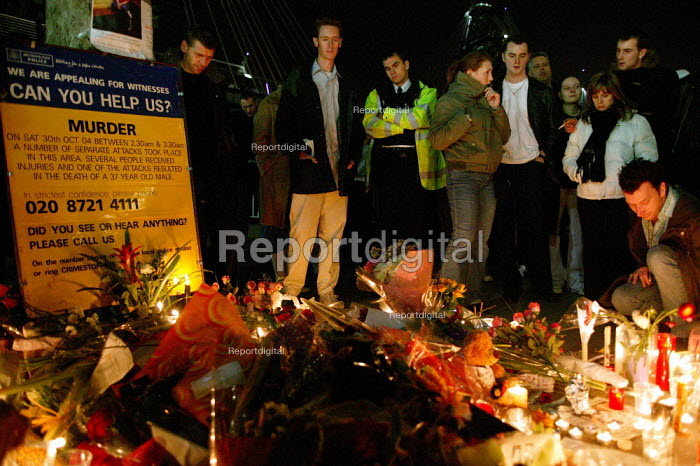 Candles and flowers left by mourners at a vigil for David Morley who was murdered in a homophobic attack on the South Bank. London. - Jess Hurd - 2004-11-05