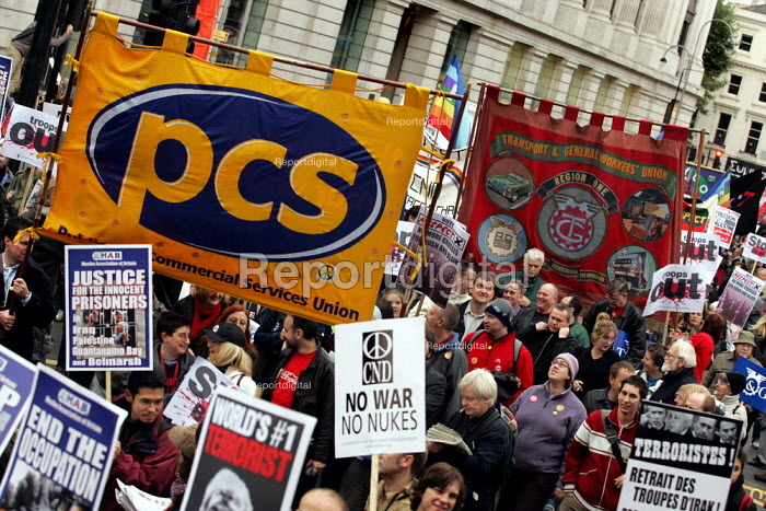 PCS and TGWU banners on the Anti war demonstration at the end of the European Social Forum held at Alexandra Palace. London. - Jess Hurd - 2004-10-17